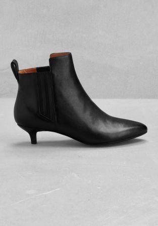 Black soft leather ankle boots with low heels - Product description. Timeless soft leather ankle boots with low heels that enclose perfect; the ankle - luxurious black nappa leather - zipper on inside - elastic band for better enclosure - available in large & small shoe sizes.